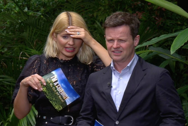 Holly and Dec look on anxiously as Emily Atack undertakes 'viper pit'