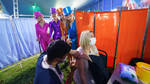 Performers from Circus Extreme watch as Rhiannon Alexander, 34 from Bradford, recieves a vaccinatio