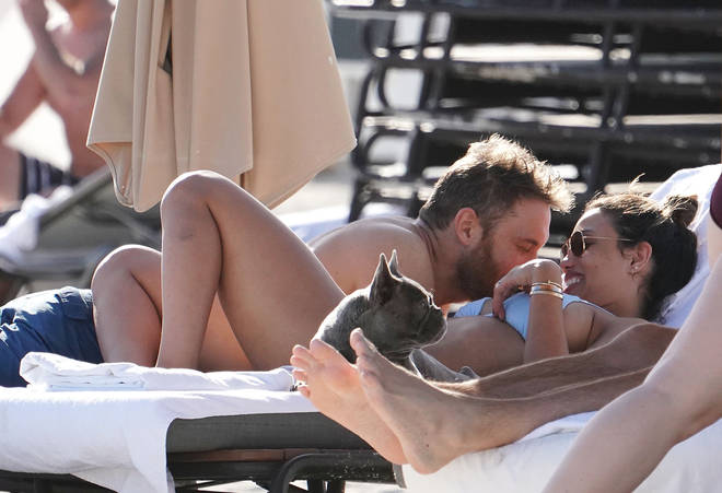David Guetta and Jessica Ledon put on the PDA in Miami.