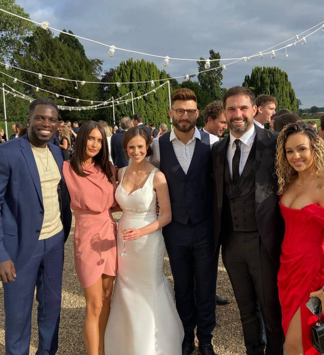 The newly betrothed pair take pictures with their guests