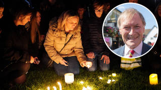 People during a candlelight vigil at Belfairs Recreation Ground near to Belfairs Methodist Church in Leigh-on-Sea, Essex, where Conservative MP Sir David Amess died after he was stabbed several times.