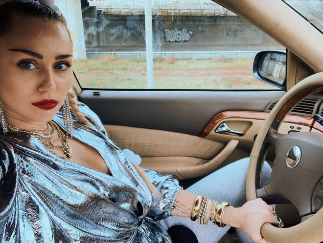 Miley Cyrus shares a behind the scenes snap from 'Nothing Breaks Like A Heart' video