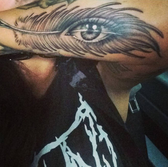 Jesy's feather with an eye tattoo was done by the famous Bang Bang New York artist