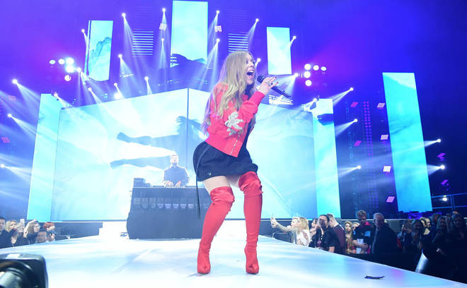 Becky Hill and Jonas Blue performing on stage at the Jingle Bell Ball 2018