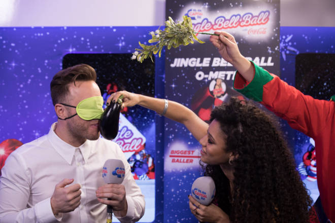 Olly Murs makes out with some vegetables at the Jingle Bell Ball 2018
