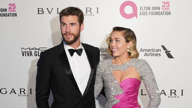 Miley Cyrus and Liam Hemsworth were happy to make red carpet appearances together