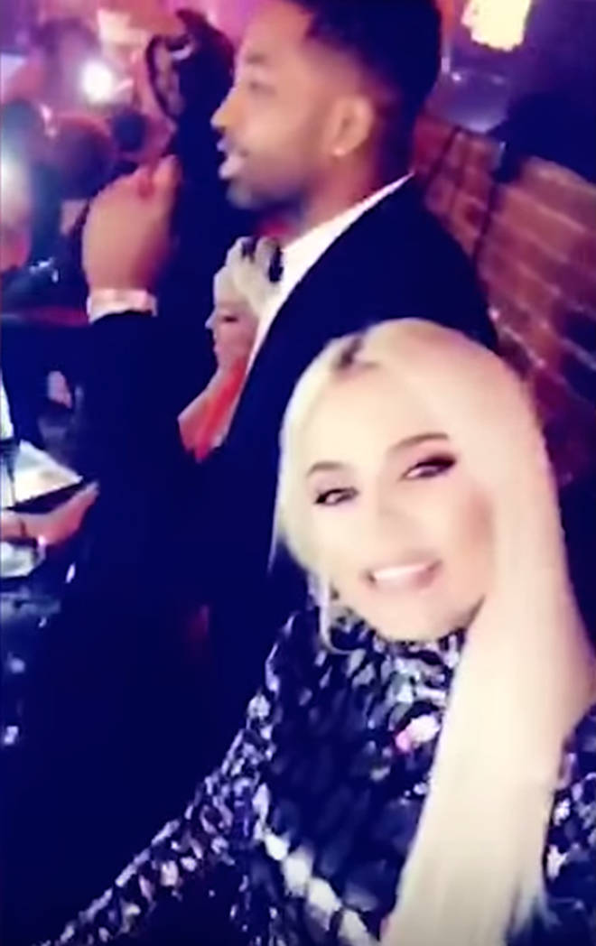Khloé Kardashian given a 'peck' by Tristan Thompson at New Year