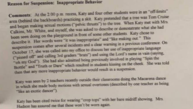 Katy Perry's report card from the 6th grade showing she was suspended for 3 days.