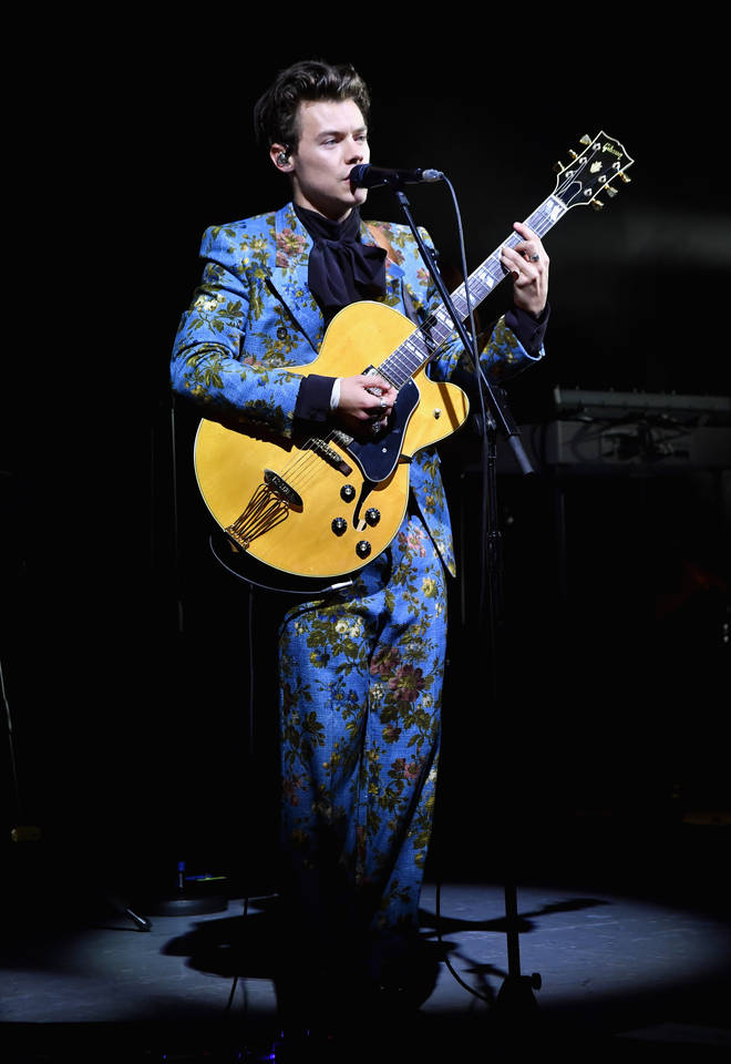 Harry Styles performs at the Greek Theatre in LA wearing vibrant blue suit