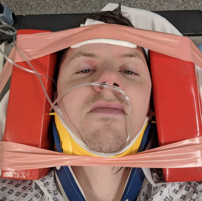 Professor Green posts a photo from the stretcher after injuring his neck after a seizure