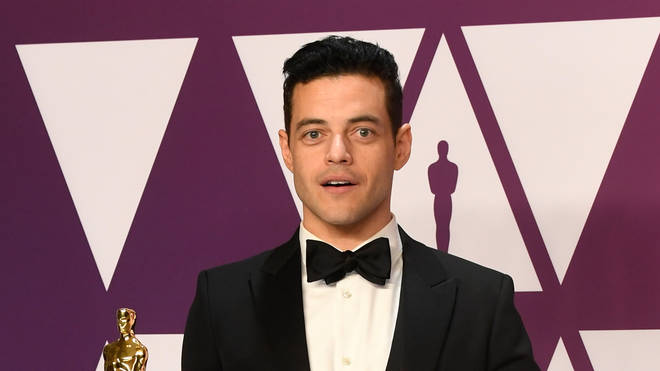 Rami Malek shows off his Oscar for Best Actor