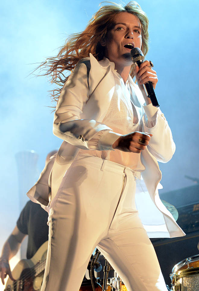 Florence Welch stunned in this white power suit - before breaking her foot
