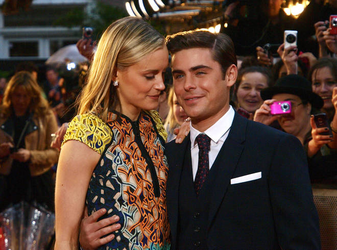 Zac Efron poses with Taylor Schilling at the premiere of The Lucky One