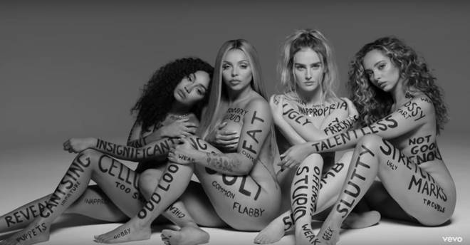 Little Mix's music video for 'Strip' saw them write insults on themselves in protest