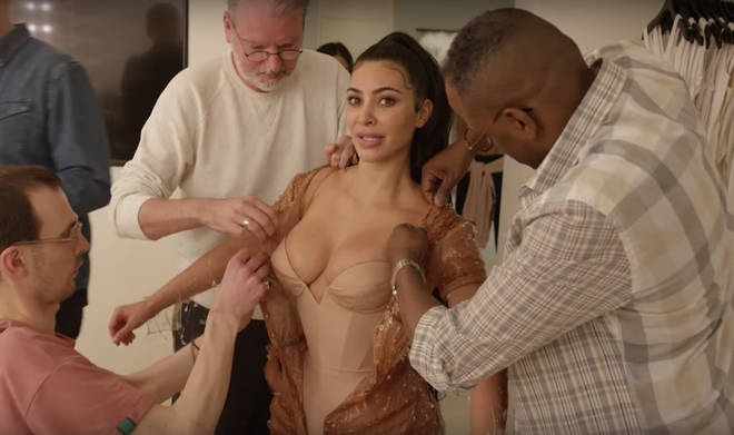 Kim Kardashian is squeezed into her outfit made of silicone
