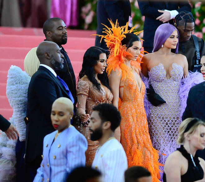 Kim Kardashian poses with Kendall and Kylie Jenner, Corey Gamble, Kanye West & Travis Scott