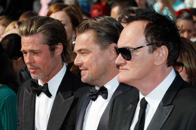 Once Upon A Time In Hollywood co-stars, Leonardo DiCaprio and Brad Pitt recall meeting Luke Perry