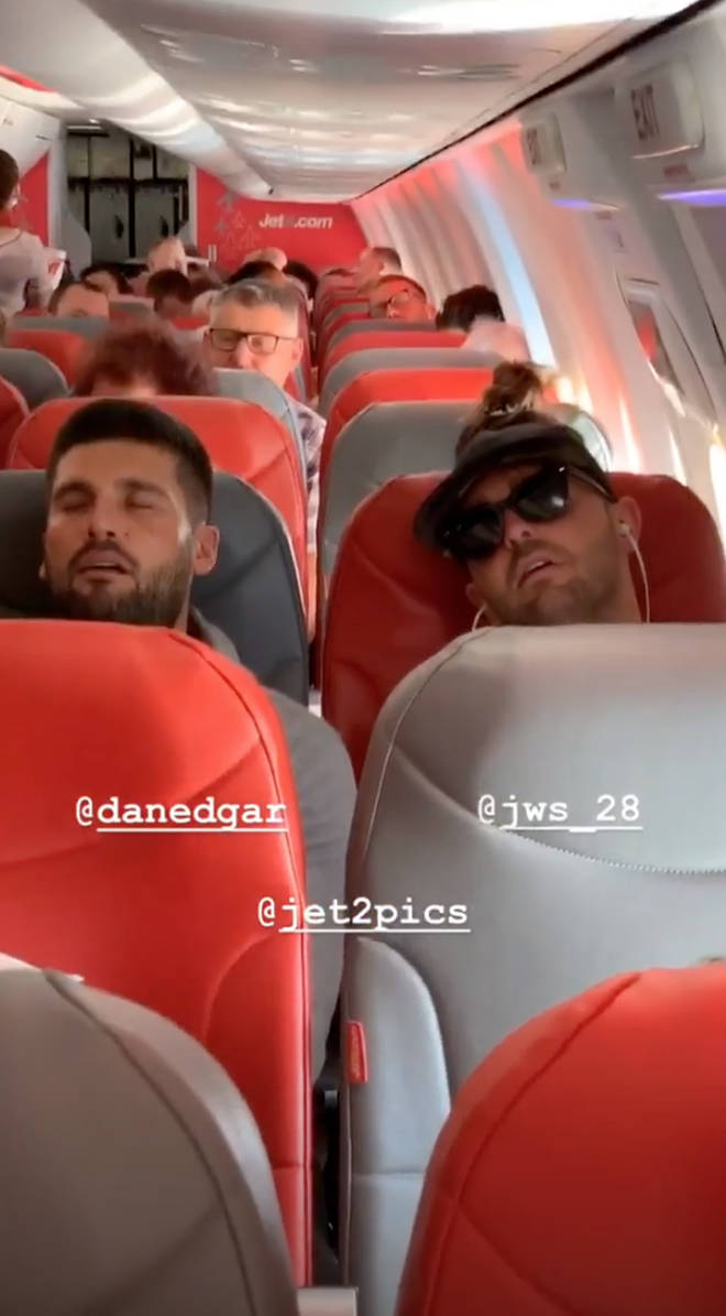 Chloe Sims took this picture of Dan Edgar asleep on the plane