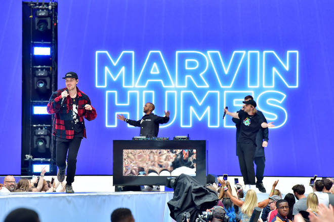 Marvin Humes and Goodboys performing on stage at Capital's Summertime Ball 2019
