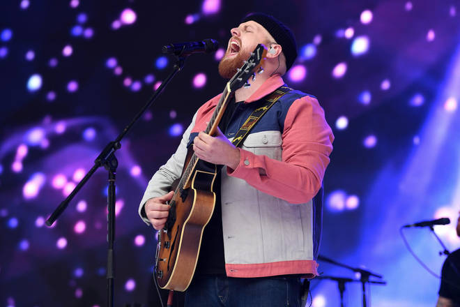 Tom Walker performing on stage at Capital's Summertime Ball 2019