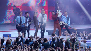 Jonas Brothers and Busted performing on stage at Capital's Summertime Ball 2019