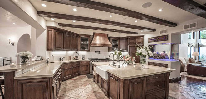 Liam Payne's kitchen includes an island and breakfast bar