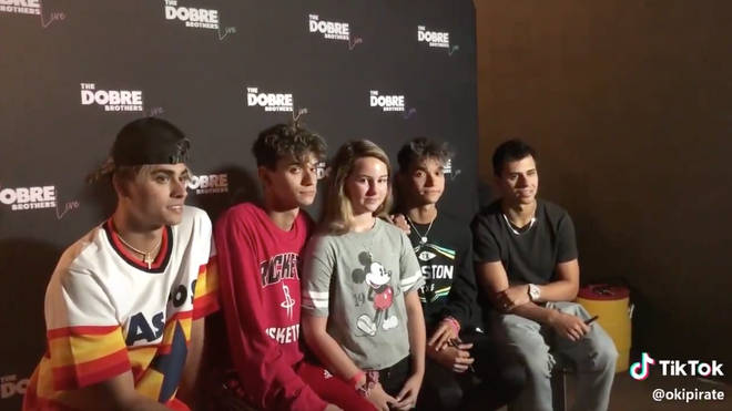 The Dobre brothers appeared bored and didn't talk to the fan who paid for a meet and greet