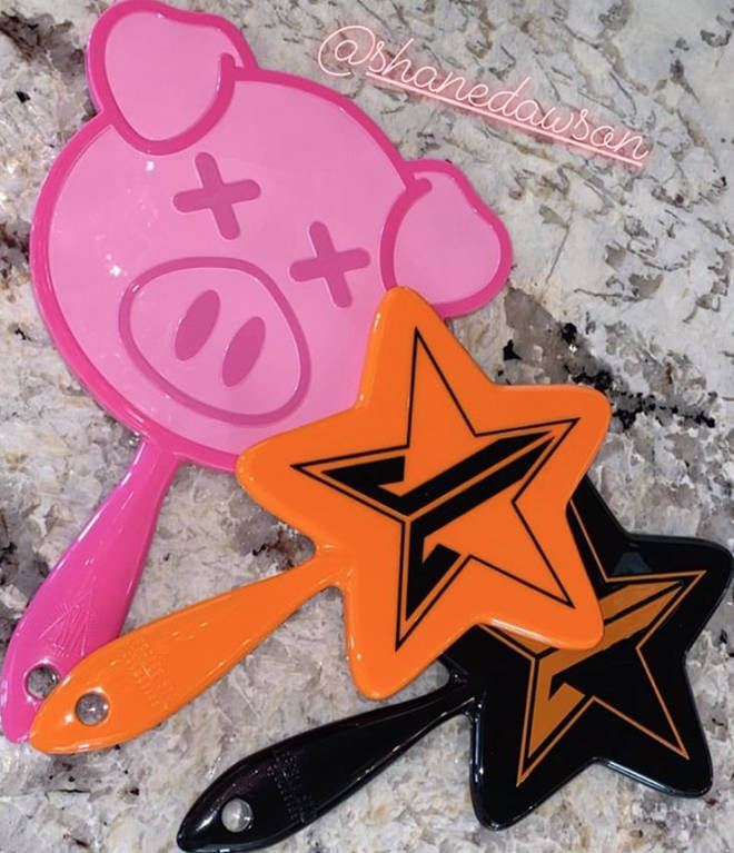Shane Dawson has a pig-themed handheld mirror in the style of Jeffree Star's star