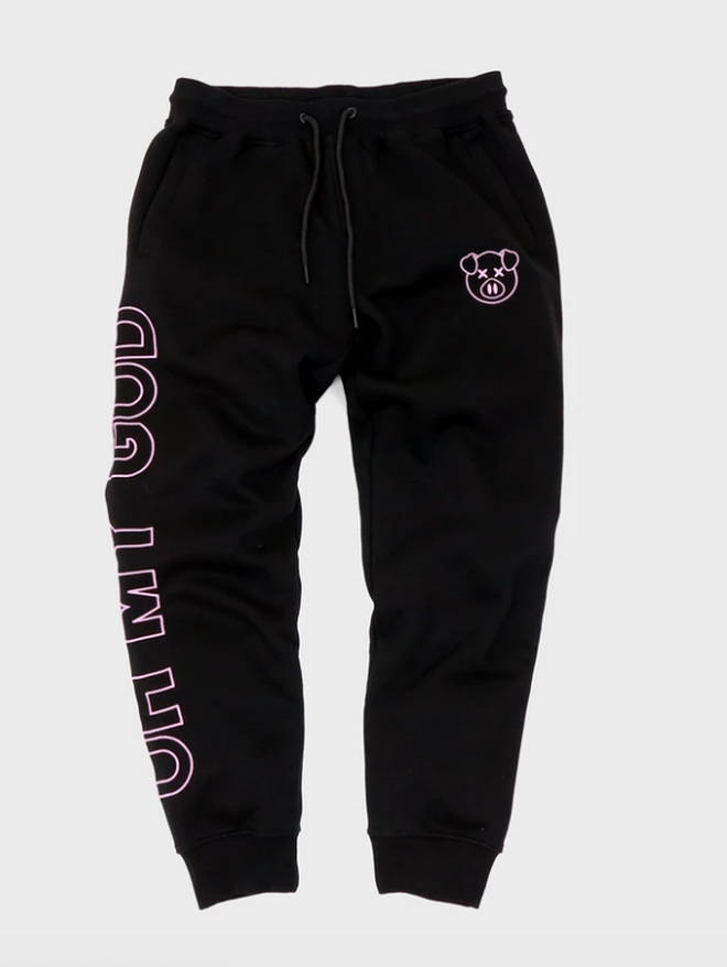 The joggers have 'oh my god' printed down one leg