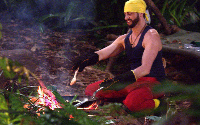 The I'm A Celeb campmates use the fire to cook the rice and beans