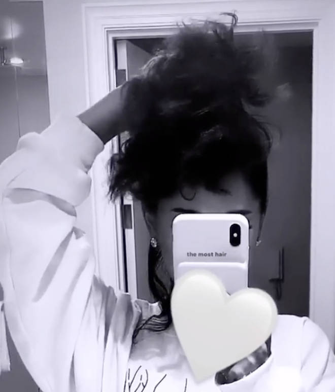 Ariana's hair is super curly.